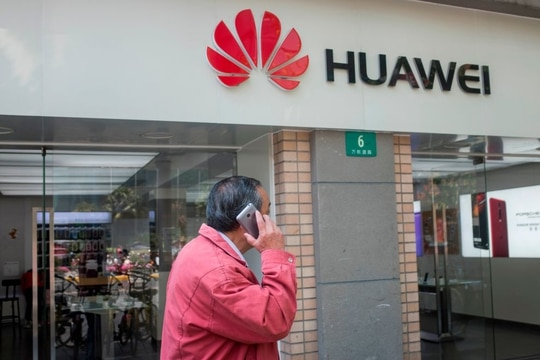 Members of Congress are upset by the U.K. government's decision to allow Huawei to build parts of its 5G network. (Johannes Eisele/ AFP via Getty Images)
