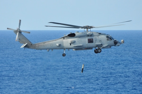 A Royal Australian Navy MH-60R Romeo helicopter conducts functional testing of the newly fitted airborne low-frequency sonar system off the coast of Jacksonville, Fla. (Commonwealth of Australia)