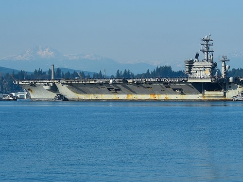 USS Nimitz (CVN 68) sailors man the rails Dec. 10, 2017, as it transits Sinclair Inlet enroute to its homecoming following a six-month deployment. (MC2 Vaughan Dill/Navy)