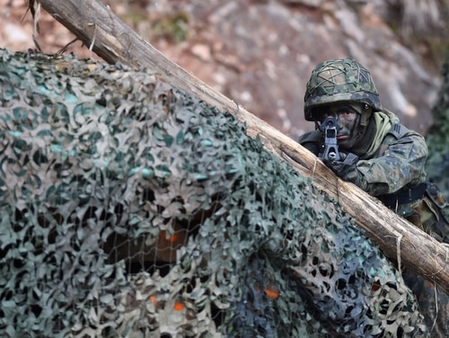 A mountain infantry soldier aims with his gun during an exercise of the German Bundeswehr in southern Germany on March 23, 2016. (Christof Stache/AFP via Getty Images)