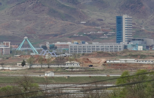 FILE - In this April 24, 2018, file photo, the Kaesong industrial complex in North Korea is seen from the Taesungdong freedom village inside the demilitarized zone during a press tour in Paju, South Korea. The rival Koreas on Friday, Sept. 14, 2018, have opened their first liaison office near their tense border to facilitate better communication and exchanges. (AP Photo/Lee Jin-man, File)