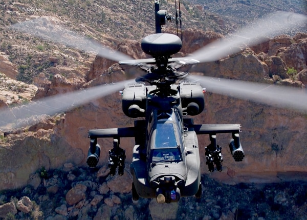 The AH-64D Longbow Apache (LBA) is a 2-engine, 4-bladed, tandem-seat attack helicopter with 30mm cannon, Hydra 70 2.75-inch rockets, laser, and Radio Frequency HELLFIRE missiles. (Army)