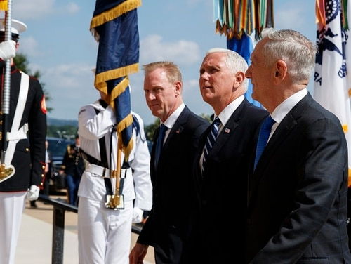Vice President Mike Pence, center, is greeted by Deputy Secretary of Defense Pat Shanahan, left, and Secretary of Defense Jim Mattis before speaking at an event on the creation of a United States Space Force at the Pentagon. (Evan Vucci/AP)