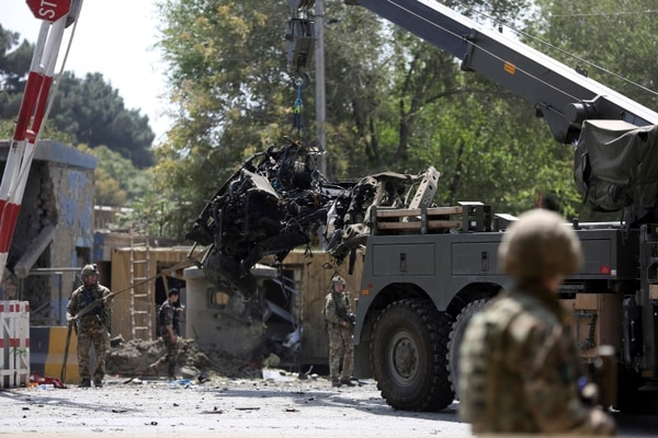 Resolute Support forces remove a damaged vehicle after a car bomb explosion in Kabul, Afghanistan, Thursday, Sept. 5, 2019. (Rahmat Gul/AP)