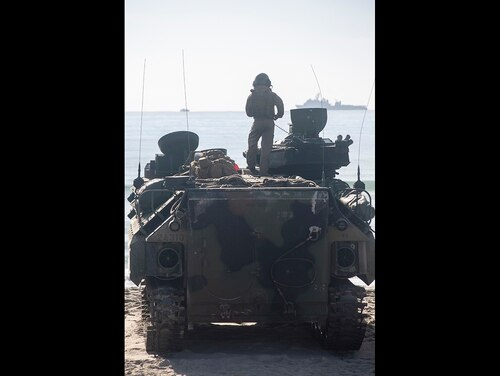 Marines prepare to splash into the Atlantic Ocean Oct. 12. (Staff Sgt Pablo D. Morrison/Marine Corps)