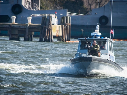 Sailors participate in port security operation scenarios as part of Citadel Shield-Solid Curtain 2019 at Virginia's Joint Expeditionary Base Little Creek-Fort Story. (Mass Communication Specialist Seaman Brendan Fitzgerald/Navy)
