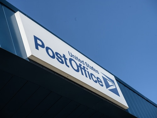 A sign is seen on a United States Postal Service (USPS) post office in Washington on Aug. 18, 2020. (Nicholas Kamm/ AFP via Getty Images)