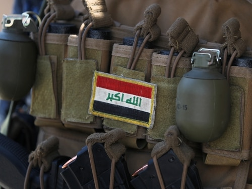 An Iraqi flag patched on the ammunition belt of a member of the Iraqi forces is seen June 19, 2017, during an offensive to retake the last district still held by the Islamic State group fighters in Mosul. (Ahmad al-Rubaye/AFP via Getty Images)