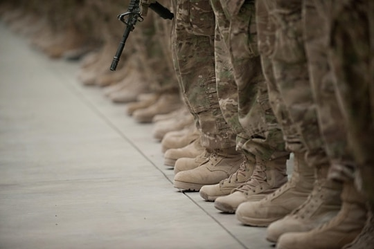 Soldiers stand in formation at Kandahar Airfield, Afghanistan. (Staff Sgt. Teddy Wade/Army)