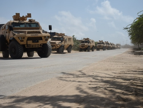A convoy of>U.S.-provided armored personnel carriers drive to the Uganda People's Defence Force compound at Mogadishu International Airport, Somalia, Sept. 25. The U.S. is working with Somalia and other African nations to counter a rise in violent extremism. (Tech. Sgt. Andria Allmond/Air Force)