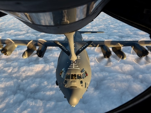 An MC-130J receives fuel from a KC-135 during training. A boom operator instructor from the 22nd Air Refueling Wing at McConnell Air Force Base in Kansas won the Air Force's first Spark Tank innovation prize for creating a new, more ergonomic platform for KC-135 operators like himself. (Senior Airman Ashley Williams/Air Force)