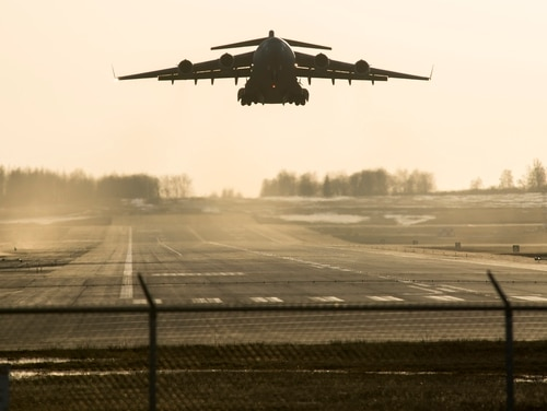 A C-17 Globemaster lll takes off during Polar Force 19-4 at Joint Base Elmendorf-Richardson, Alaska, April 1. A C-17 crew's stop at a Scottish airport during their trip from Elmendorf to Kuwait, where they stayed at a property owned by President Trump, has sparked an investigation by lawmakers. (Airman 1st Class Jonathan Valdes Montijo/Air Force)