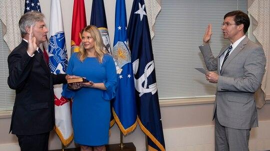 Kenneth J. Braithwaite, the 77th Secretary of the Navy, was sworn in Friday by Defense Secretary Mark Esper. His wife Melissa held the Bible. (Navy)
