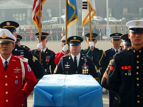In this Feb. 14, 2003, file photo, United Nations Command troops stand around the coffin of one Korean War-era remains during an honor guard departure ceremony, at Yongsan U.S. Army Base in Seoul, South Korea. The most tangible outcome of the summit between President Donald Trump and North Korean leader Kim Jong Un seems to be a commitment to recover the remains of U.S. military personnel missing in action and presumed dead from the Korean War. (Yun Jai-hyoung/AP)