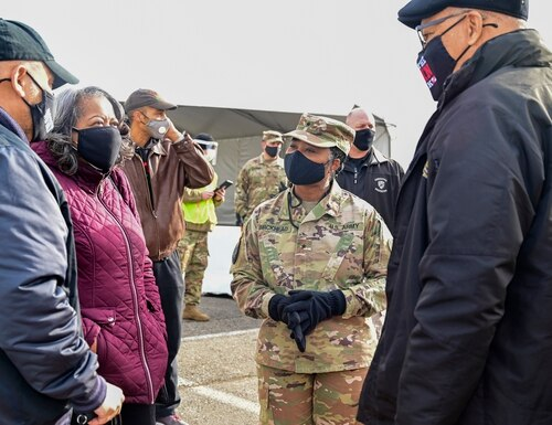 Army Brig. Gen. Janeen Birckhead, commander of the Maryland Army National Guard and leader of the state's Vaccine Equity Task Force, visits one of the state's first COVID-19 mass vaccination sites at Six Flags America, in Bowie, Maryland, on Feb. 6, 2021. (U.S. Air National Guard photo by Tech. Sgt. Enjoli Saunders).