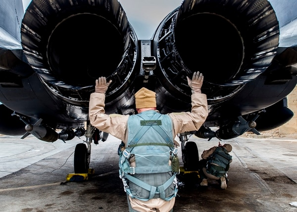 Col. David Brynteson, the 332nd Expeditionary Operations Group commander, checks the engines on an F-15 in Southwest Asia while preparing to fly his last sortie in theater. (Staff Sgt. Eboni Reams/Air Force)