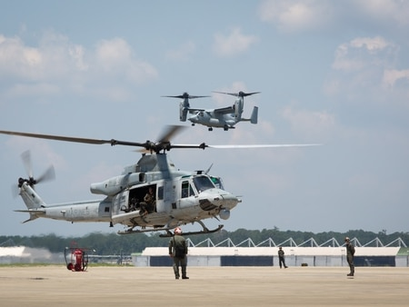 A U.S. Marine Corps UH-1Y Huey and MV-22 Osprey prepare for landing during a homecoming reception at Marine Corps Air Station New River, N.C., on July 14, 2019. (Cpl. Cody Rowe/Marine Corps)
