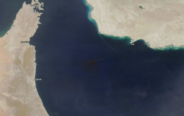 The smoke from tankers burning in the Gulf of Oman can be seen from space.