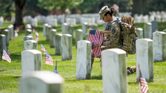 Soldiers with the 3d U.S. Infantry Regiment (The Old Guard) place flags at headstones in Arlington National Cemetery, Arlington, Va., during Flags-In, May 23, 2019. Over 280,000 American flags are placed at each headstone in the cemetery before Memorial Day. (Sgt. Nicholas T. Holmes/Army)