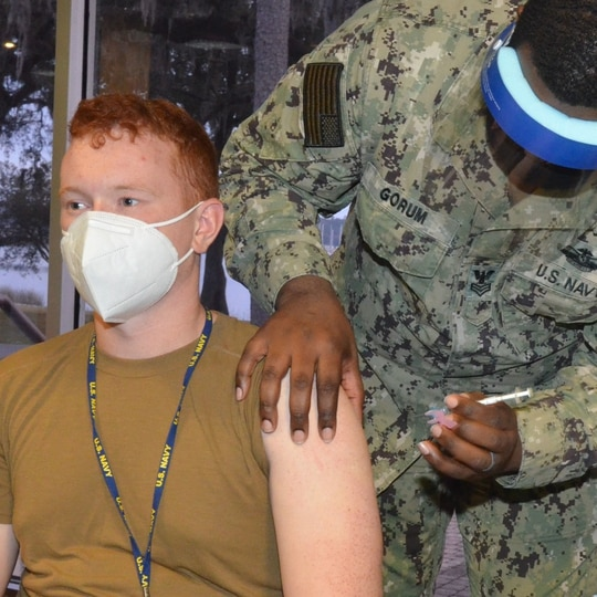 Navy Aviation Boatswain's Mate Airman Austin Pine, of the Wasp-class amphibious assault ship Iwo Jima, gets a COVID vaccination Jan. 11, 2021. (Deirdre Smith/Naval Hospital Jacksonville)