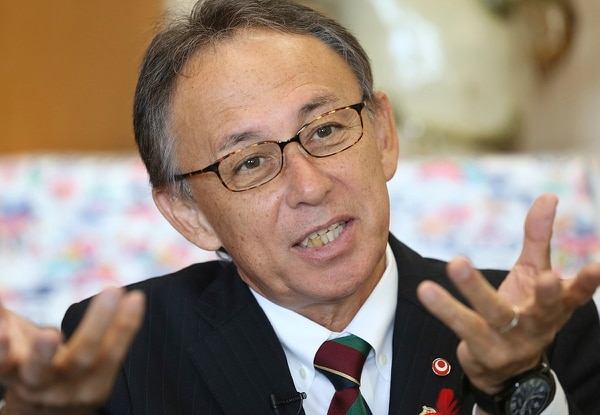 Denny Tamaki, governor of Okinawa, speaks during an interview with the Associated Press in Tokyo, Wednesday, Oct. 31, 2018. Tamaki, the newly elected governor of the southern Japanese island of Okinawa, is headed to the U.S. with a message to the American people: Stop building the military base and build peace instead.(Koji Sasahara/AP)