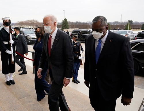 President Joe Biden, center, and Vice President Kamala Harris, left, walk with Secretary of Defense Lloyd Austin, right, at the Pentagon on Feb. 10, 2021. (Alex Brandon/AP)