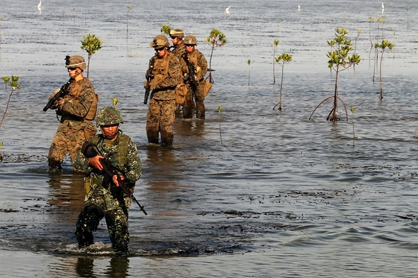 U.S. Marines with 2d Battalion, 2d Marine Regiment, Golf Company, and Filipino Marines with 4th Marine Regiment patrol through the Mangroves in Puerto Princesa during Balikatan 2016 (BK 16) on April 10, 2016. The purpose of BK 16 is to strengthen interoperability and partner-nation capabilities for the planning and execution of military operations, and advance regional security operations. (U.S. photo by Lance Cpl. Damon A. Mclean/Released)