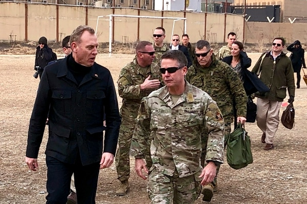 Acting Defense Secretary Pat Shanahan, left, arrives in Kabul, Afghanistan, Monday morning, Feb. 11, 2019, to consult with Army Gen. Scott Miller, right, commander of U.S. and coalition forces, and senior Afghan government leaders. The unannounced visit is the first for the acting secretary of defense, Pat Shanahan. He previously was the No. 2 official under Jim Mattis, who resigned as defense chief in December. (Robert Burns/AP)