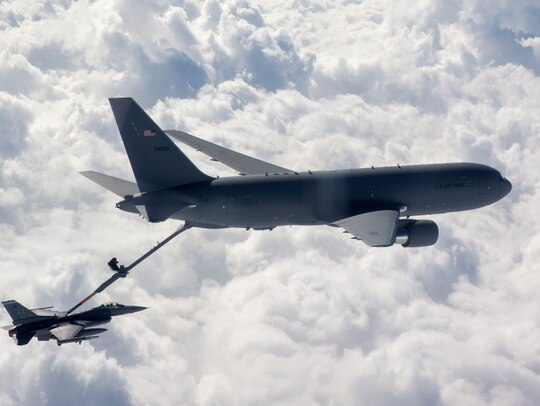 A F-16 fighter jet, left, receives fuel from a KC-46 Pegasus during a flutter mission at Eglin Air Force Base, Fla., on Dec. 12, 2019. This was the first operational refueling by the new McConnell Air Force Base aircraft, which only had a total of 11 flight hours. (Tech. Sgt. John Raven/U.S. Air Force)