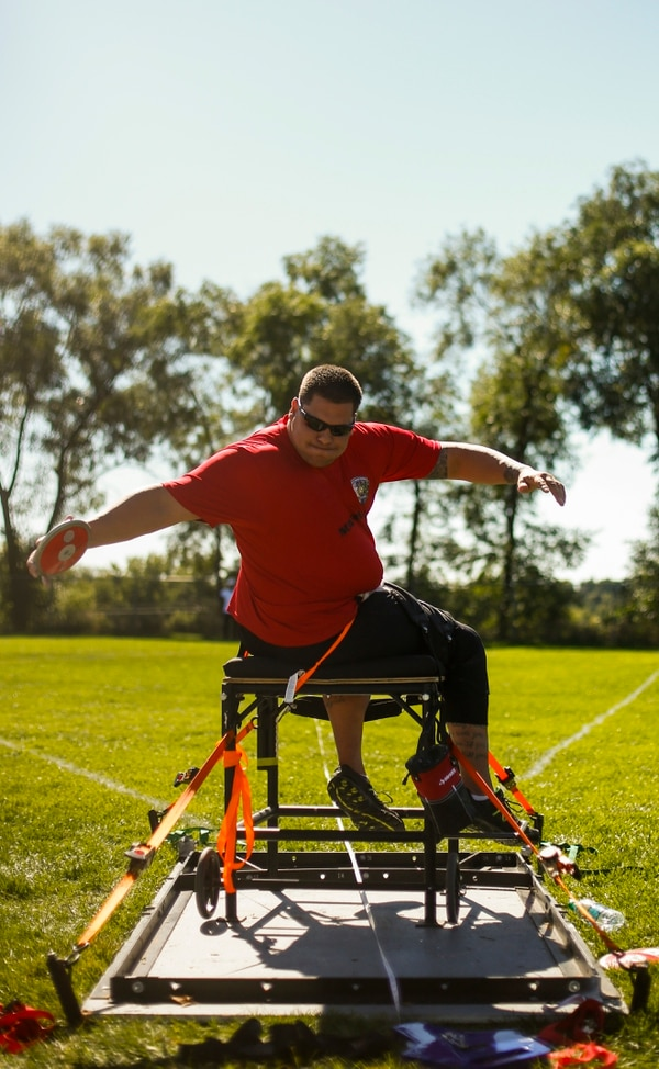 Marine Corps' Michael Wishnia throws discus in the F57 disability division at the 2014 Warrior Games at Garry Berry Stadium in Colorado Springs, Colorado, on Thursday, October 2, 2014. (Mike Morones/Staff)