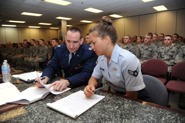Updates to the UCMJ that went into effect Jan. 1 include changes to courts-martial proceedings. Here, a trial prosecutor and paralegal review documents during a summary court-martial at Keesler Air Force Base, Miss. (Kemberly Groue/Air Force)
