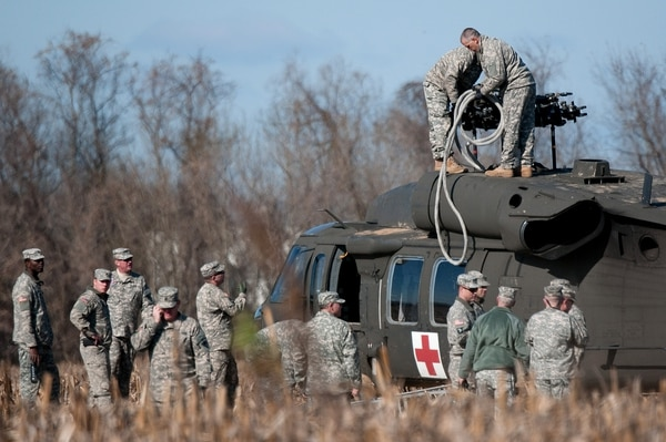 U.S. Soldiers from the S.C. Army National Guard work to prepare a UH-60 Black Hawk from Detachment 2, Company F, 1-171st General Support Aviation Battalion, S.C. Army National Guard, for sling-load movement to McEntire Joint National Guard Base, Eastover, S.C. Dec. 7, 2014. The Black Hawk made an emergency landing in an open field Dec. 3, 2014 due to a main rotor blade malfunction in Columbia, S.C. The Black Hawk was released by the Accident Review Board for recovery and was being transported via sling-load under a S.C. Army National Guard CH-47 Chinook helicopter from Detachment 1, B-Company, 2-238th General Support Aviation Battalion, S.C. Army National Guard Army Aviation Support Facility in Greenville, S.C. The cause of the main rotor malfunction remains under investigation. (US Army National Guard Photo by Staff Sgt. Di Giovine/Released)