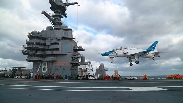 A T-45 Goshawk, assigned to Air Test and Evaluation Squadron (VX) 23, lands aboard the carrier Gerald R. Ford's flight deck. The Navy is pouring more than $200 million in research and development funding toward the ship class. (MC2 Ruben Reed/U.S. Navy)