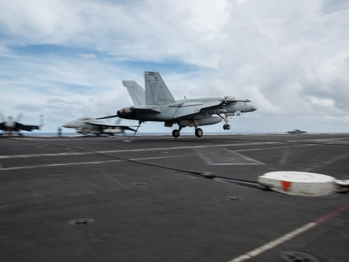 An F/A-18E Super Hornet lands on the aircraft carrier Ronald Reagan earlier in June. (Navy)