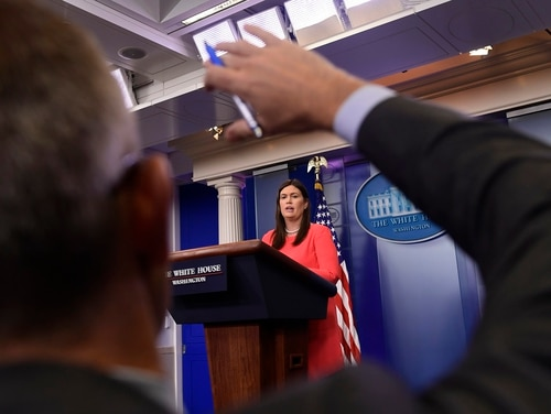 White House press secretary Sarah Huckabee Sanders speaks during the daily briefing at the White House on May 17, 2018. Sanders announced at the briefing that President Donald Trump has donated his first-quarter salary of $100,000 to the Department of Veterans Affairs. (Susan Walsh/AP)