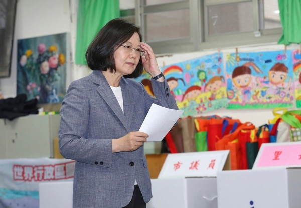 Taiwanese President Tsai Ing-wen waits to cast her ballot at a polling station on Saturday in Taipei. (Chang Haoan/ Pool Photo via AP)