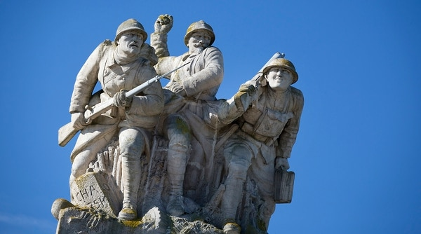 In this Oct. 14, 2014, file photo, a statue of three soldiers at the World War I Navarin Memorial in Souain-Perthes-les-Hurlus, France. Located in the spot where the Battle of Champagne raged and depicts three patrolling soldiers in the guise of Gen. Gouraud, Lt. Quentin Roosevelt, the son of U.S. President Theodore Roosevelt, who died in 1918 in the Tardenois, and the brother of the sculptor who fell on the Chemin des Dames. (Virginia Mayo/AP)
