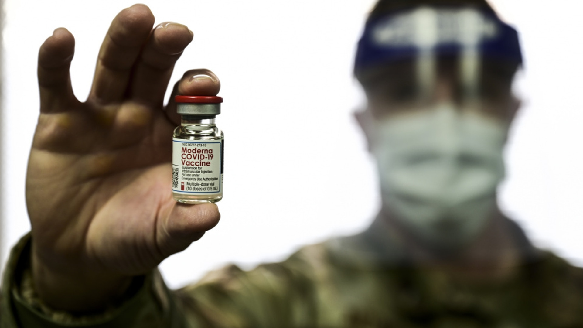 Tech. Sgt. Joseph Anthony, of the 911th Aeromedical Staging Squadron, holds a COVID-19 vaccine vial at the Pittsburgh International Airport Air Reserve Station, Pennsylvania, Feb. 4, 2021. (Joshua J. Seybert/Air Force)