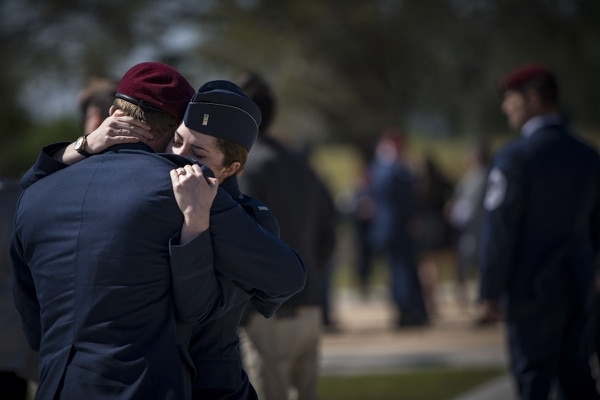 Airmen embrace following a memorial service in honor of Capt. Mark Weber at Moody Air Force Base, Ga. (Staff Sgt. Ryan Callaghan/Air Force)