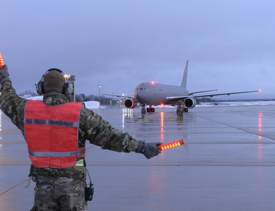 New Hampshire Air National Guard Staff Sgt. Joseph Chase, a flightline crew chief with the 157th Maintenance Squadron, marshals the Wing's fifth and newest KC-46A air refueling tanker upon its arrival from Boeing, Feb. 7, 2020. (Tech. Sgt. Aaron Vezeau/U.S. Air National Guard)