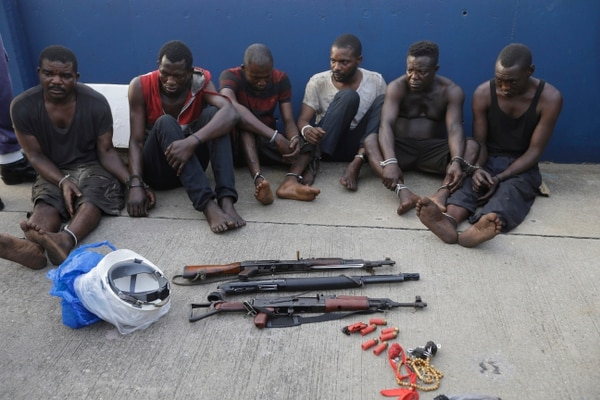 Arrested pirates that hijacked the Panama-flagged Maximus vessel are shown to the media in Lagos, Nigeria Monday, Feb. 22, 2016. Nigerian sailors rescued a hijacked oil tanker in a dramatic night-time rescue in which they killed one pirate, the Nigerian navy announced as it escorted the ship into Lagos harbor Monday. (AP Photo/Sunday Alamba)