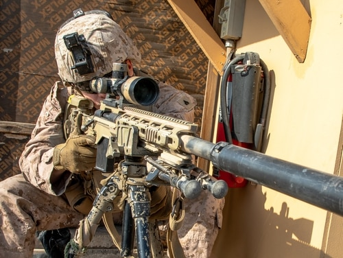 A U.S. Marine with 2nd Battalion, 7th Marines, assigned to the Special Purpose Marine Air-Ground Task Force-Crisis Response-Central Command (SPMAGTF-CR-CC) 19.2, provides long-range over watch security with an M40A6 sniper rifle at the Baghdad Embassy Compound in Iraq, Jan. 3, 2020. (Sgt. Kyle C. Talbot/Marine Corps)