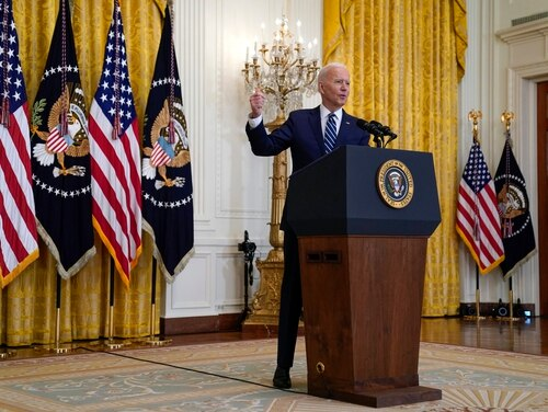 President Joe Biden speaks during a news conference in the East Room of the White House on March 25. (Evan Vucci/AP)