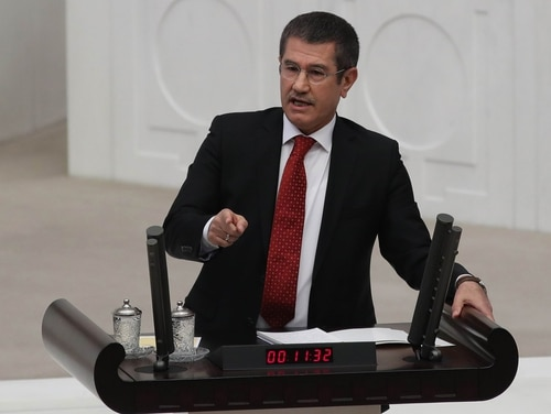 """Turkish Minister of Defence Nurettin Canikli delivers a speech during an emergency session on a government request to extend military operations in neighboring Iraq and Syria at the Grand National Assembly of Turkey in Ankara on Sept. 23, 2017. The minister says """"several U.S. and German companies"""" were implementing a """"covered"""" [indirect] arms embargo on Turkey. (Adem Altan/AFP via Getty Images)"""