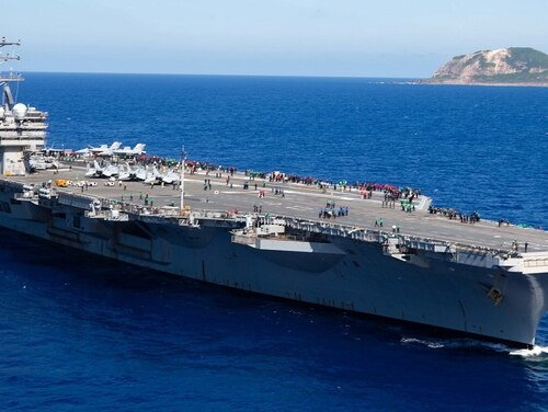 The aircraft carrier Ronald Reagan steams off the coast of Iwo To, formerly known as Iwo Jima, May 22. The carrier, homeported in Yokosuka, Japan, will head to U.S. 5th Fleet early this summer to provide security during the U.S. withdrawal from Afghanistan. (MC2 Jason Tarleton/Navy)