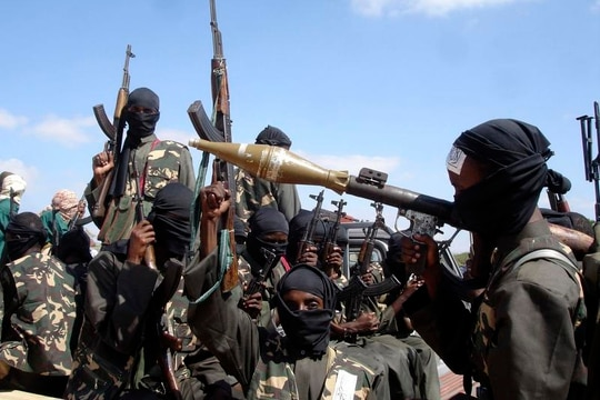 In this Dec. 8, 2008 file photo, armed al-Shabab fighters on pickup trucks prepare to travel into the city, just outside Mogadishu, in Somalia. (AP Photo/Farah Abdi Warsameh, File)