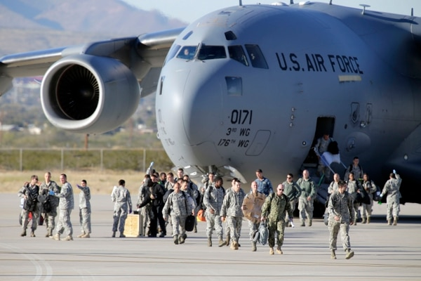 Sixty-nine U.S. service members from all four branches of service return from West Africa supporting Operation United Assistance, Tuesday, Nov. 18, 2014 at Fort Bliss, in El Paso, Texas. They will undergo a mandatory 21-day quarantine period. (AP Photo/The El Paso Times, Ruben R Ramirez) EL DIARIO OUT; JUAREZ MEXICO OUT