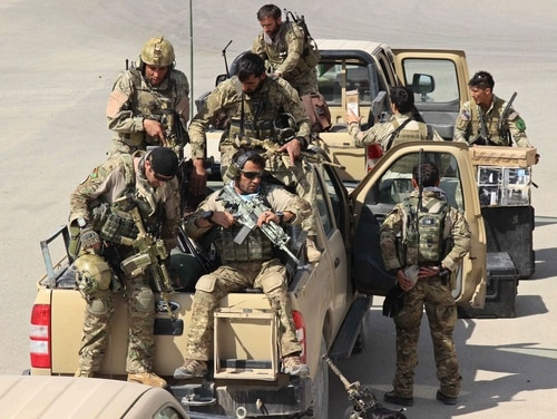 Afghan special forces arrive, as they launch a counteroffensive to retake the city from Taliban insurgents, in Kunduz on September 29, 2015.