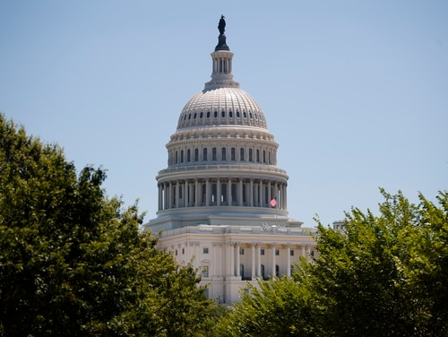 The Democratic-led House passed legislation Thursday to repeal the 2002 war authorization for Iraq and to bar funding for military action in Iran, in an effort to reclaim Congress's war powers amid regional tensions. (Carolyn Kaster/AP)