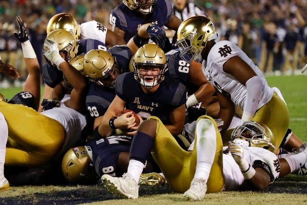 Navy quarterback Zach Abey, center, scores a touchdown against Notre Dame in San Diego. (Gregory Bull/AP)